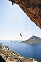 Greece, Kalymnos, climber abseiling in rock wall - LMF00672