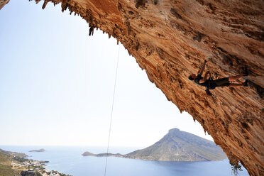 Greece, Kalymnos, climber in rock wall - LMF00675