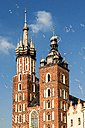 Poland, Krakow, Old Town, Main Square, spires of the St Mary Basilica and soap bubbles - CSTF01236