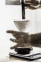 Man's hands preparing filter coffee - SKAF00041