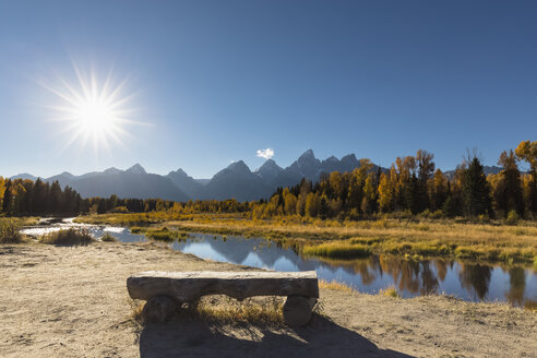 USA, Wyoming, Grand Teton National Park, view to Teton Range with Snake River and bench in the foreground - FOF08902