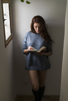 Attractive young woman reading book - KKAF00469