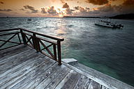 Caribbean, Dominican Republic, jetty at Bavaro Beach at sunrise - DSGF01461