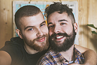 Portrait of happy young gay couple taking selfie - RTBF00686