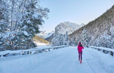 Austria, Tyrol, Karwendel, Riss Valley, woman jogging in winter - MRF01698