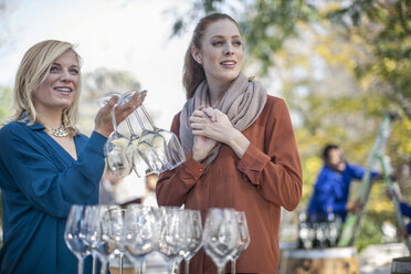 Two women with wine glasses outdoors - ZEF12883