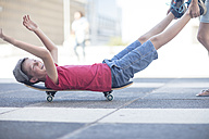 Kids skateboarding in the street - ZEF12904