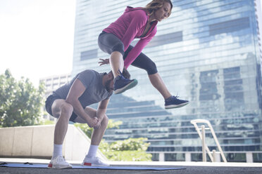Couple exercising in the city - ZEF12936