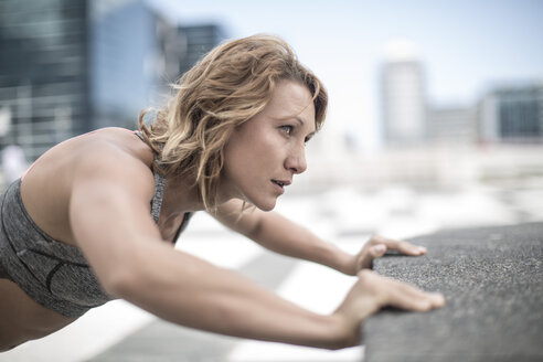 Young woman exercising in the city - ZEF12939
