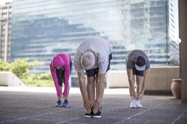 Three athletes doing gymnastics in the city - ZEF12948
