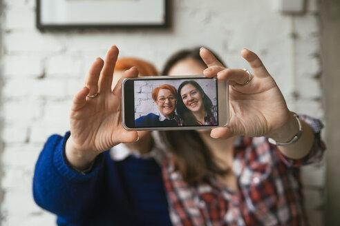Selfie of smiling adult daughter with mother - ZEDF00523