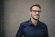 Portrait of smiling businessman - KNSF01043