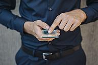 Businessman using futuristic portable device - KNSF01058