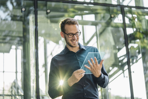Businessman using futuristic portable device - KNSF01112