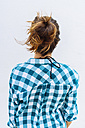 Young woman wearing checkered shirt, rear view - GIOF02033