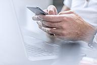 Businessman using smart phone - ZEF12958