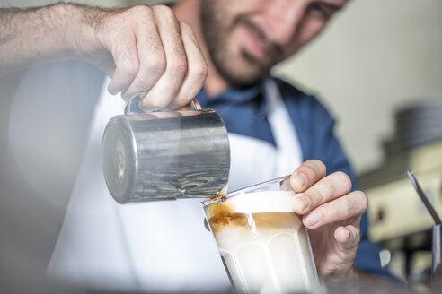 Barista preparing Latte Macchiato - ZEF12997