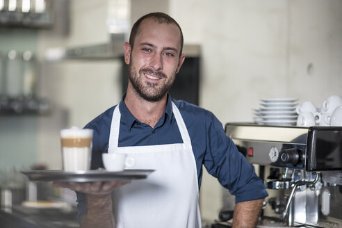 Portrait of smiling barista serving Latte Macchiato - ZEF13000