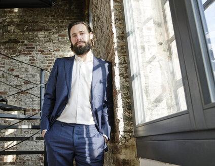 Portrait of confident businessman - FMKF03519