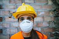 Portrait of woman wearing dust mask - KIJF01279