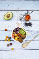 Lunch bowls of leaf salad, red cabbage, avocado, tomatoes, quinoa fritters and ajvar - LVF05902