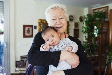 Portrait of smiling great-grandmother holding baby - GEMF01515