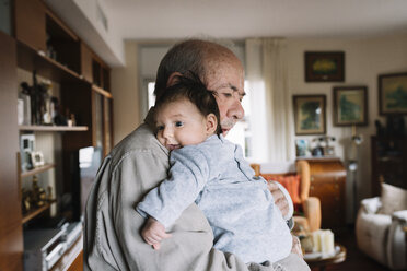 Great-grandfather holding baby at home - GEMF01518