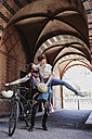 Happy couple with electric bicycle - RORF00654