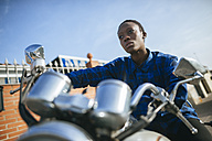 Young woman on motorbike - KIJF01296