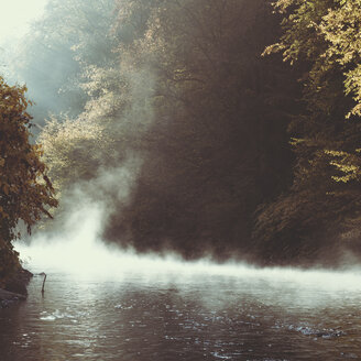 Germany, Wuppertal, rising fog on river Wupper in the morning - DWIF00835