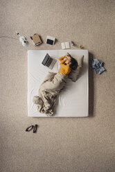 Woman lying in bed next to laptop, top view - JOSF00615