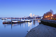 UK, London, floating workshops on River Thames and Canary Wharf in background at blue hour - BRF01435