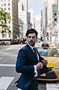 Handsome businessman walking in Manhattan - GIOF02039