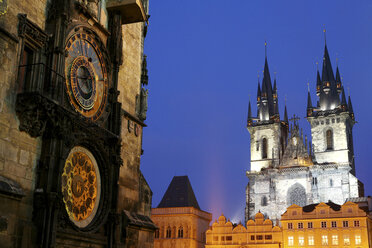 Czechia, Prague, part of Town Hall with Astronomic Clock and Church of Our Lady Before Tyn at dusk - DSGF01500