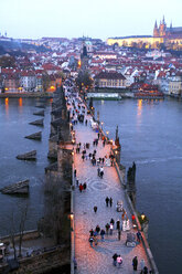 Czechia, Prague, cityscape with Charles Bridge at dusk seen from above - DSGF01515
