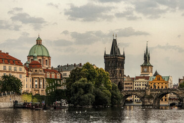 Czechia, Prague, Old town, Church of St Francis, Charles Bridge and Old Town Bridge Tower in the evening - CSTF01309