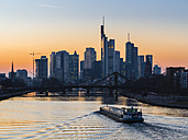 Germany, Frankfurt, view to skyline with Floesserbruecke and Main River in the foreground at morning twilight - AMF05299