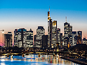 Germany, Frankfurt, view to skyline with Floesserbruecke and Main River in the foreground at twilight - AMF05302