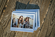 Stack of instant photos of two best friends - KIJF01326
