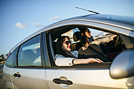 Two young women traveling in a car - KIJF01332