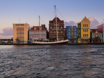 Curacao, Willemstad, schooner and colorful houses at waterfront promenade - AMF05307