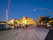 Curacao, Willemstad, Punda, colorful houses at waterfront promenade in the evening seen from Queen Emma Bridge - AM05310
