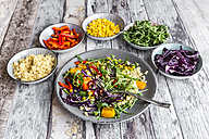 Plate of rainbow salad with bulgur, rocket and different vegetables - SARF03243