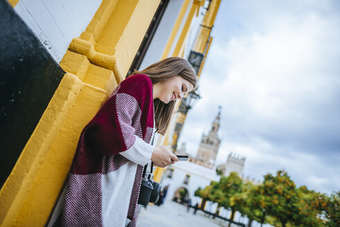 Young woman in Sevilla using smart phone - KIJF01345