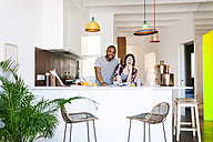 Young couple having breakfast in the kitchen - VABF01206
