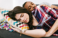 Young couple taking a nap on the sofa - VABF01212