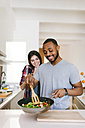 Young couple cooking together at home - VABF01215
