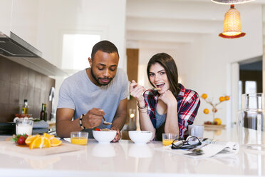 Young couple having breakfast in the kitchen - VABF01221