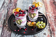 Two glasses of chia pudding with several fruits - SARF03252