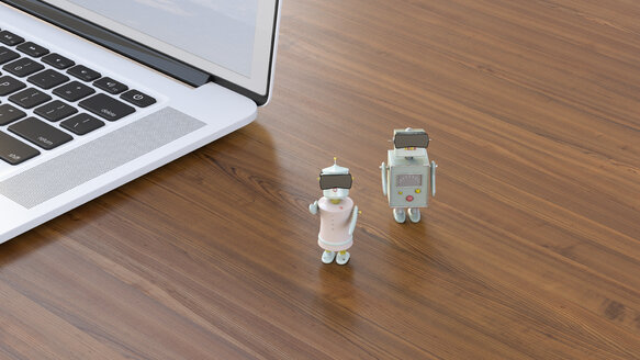 Two robots at laptop wearing virtual reality glasses, 3D rendering - UWF01139